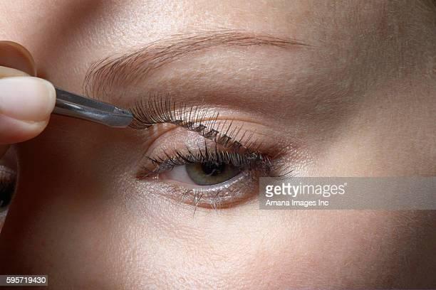 Woman Attaching Fake Eyelashes