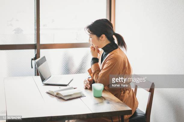 woman attending online video meeting at home - mindzoom 2 stock pictures, royalty-free photos & images