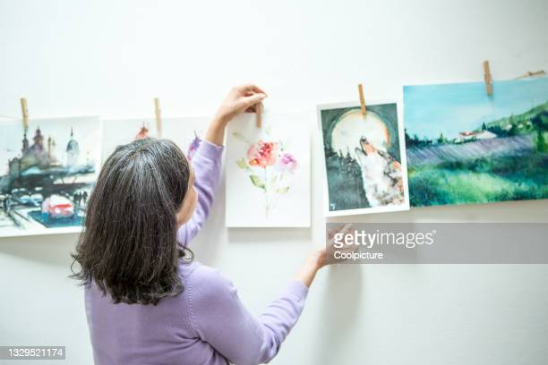 woman attending painting workshop - entertainment event stock pictures, royalty-free photos & images