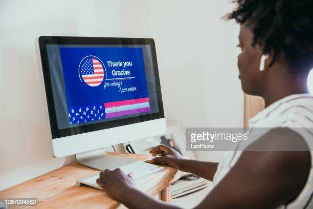 woman attending to online voting for the next election - polling station stock pictures, royalty-free photos & images