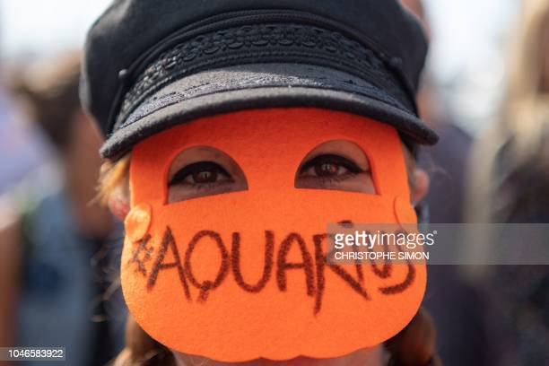 A woman attends a demonstration in support to the Aquarius an NGO boat dedicated to the rescue of migrants at sea in Marseille's vieux port on...