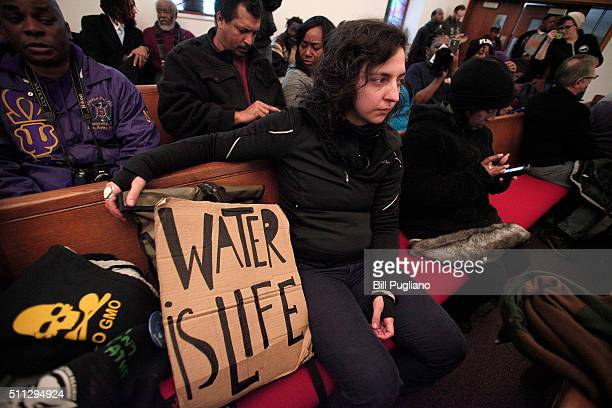 A woman attends a prayer service prior to participating in a national milelong march to highlight the push for clean water in Flint February 19 2016...
