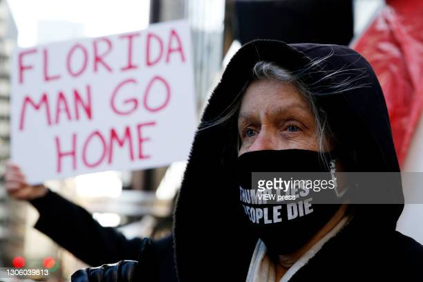 Woman attends a protest against the former U.S. President Donald Trump at Trump Tower on March 08, 2021 in New York. Trump is returning to New York...