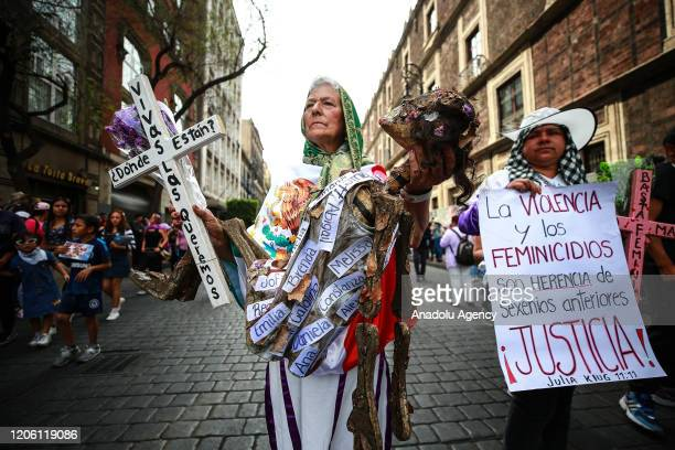 A woman attends a protest on the International Women's Day in Mexico City Mexico on March 8 2020