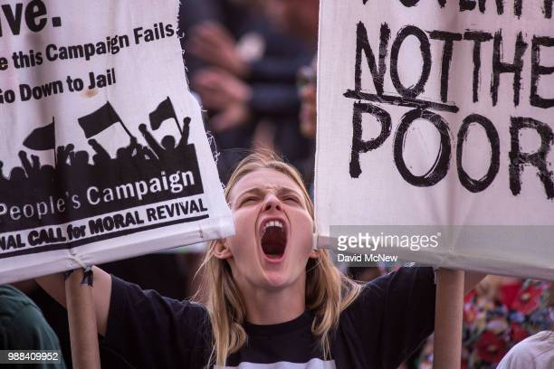 A woman attends a protest outside the Metropolitan Detention Center after marching to decry Trump administration immigration and refugee policies on...