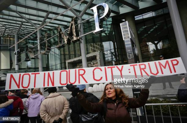 A woman attends a protest outside the Trump International Hotel and Tower in Canada's Vancouver on Feb 28 the building's official opening day