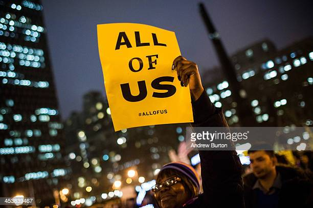 A woman attends a rally calling on greater social equality organized by nonunionized fast food workers demanding for a wage raise from $725 per hour...