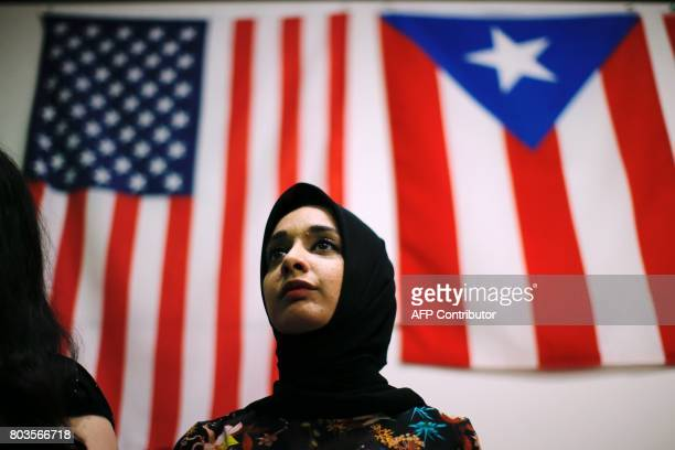 A woman attends a town hall meeting following a rally to protest restrictive guidelines issued by the US on who qualifies as a close familial...