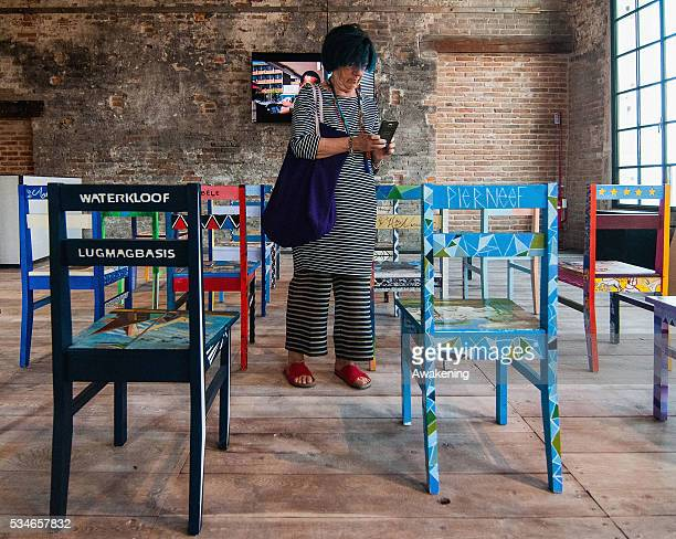 A woman attends at the South Africa Pavillion of the 15th Architecture Venice Biennale on May 27 2016 in Venice Italy The 15th International...