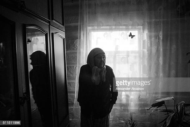 REGION SIBERIA RUSSIA OCTOBER 3 2015 A woman attends Kurban Bayram celebration in one of the houses in the village of Kuskurgul Tyumen region Russia...