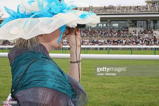 A woman attends the 161th Prix de Diane horse racing on June 13 2010 in Chantilly France Oddson favourite Sarafina won the Prix de Diane at Chantilly...