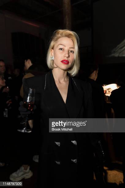 A woman attends the Angels by Russell James Australian Book Launch during MercedesBenz Fashion Week Resort 20 Collections at Carriageworks on May 13...