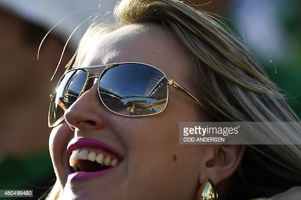 A woman attends the opening ceremony of the 2014 FIFA football World Cup at the Corinthians Arena in Sao Paulo on June 12 2014 AFP PHOTO / ODD...