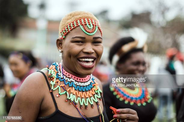 Woman attired in Zulu traditional regalia joins thousands of people to commemorate King Shaka's Day Celebration near the grave of the great Zulu King...