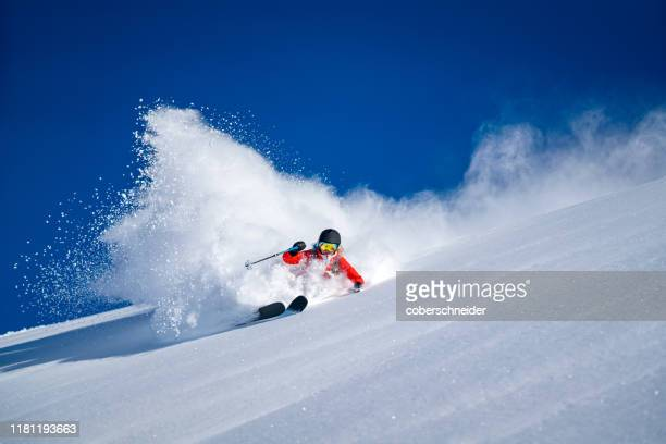 woman backcountry powder skiing in bad gastein, salzburg, austria - skifahren stock-fotos und bilder