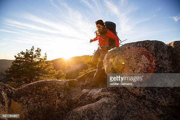 a woman backpacking. - extreme terrain stock pictures, royalty-free photos & images
