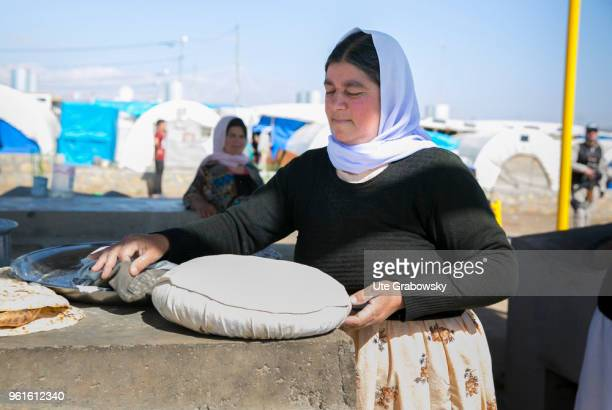 A woman bakes traditional bread in the refugee camp Kabarto 2 in the district Semeel on April 23 2018 in DOHUK IRAQ