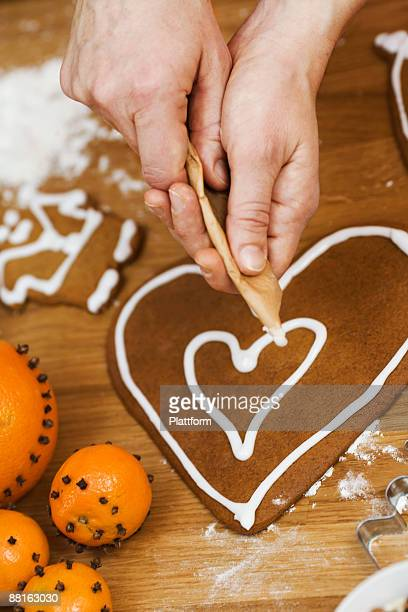 A woman baking ginger bread biscuits Sweden.