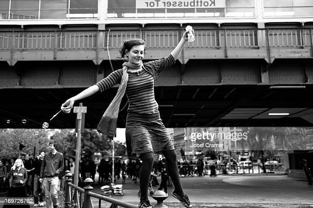 Woman balancing at Kottbusser Tor Berlin Occupy Demonstration