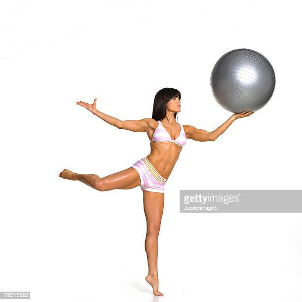 Woman Balancing Exercise Ball
