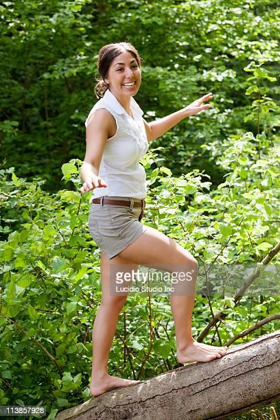 Woman balancing on a log