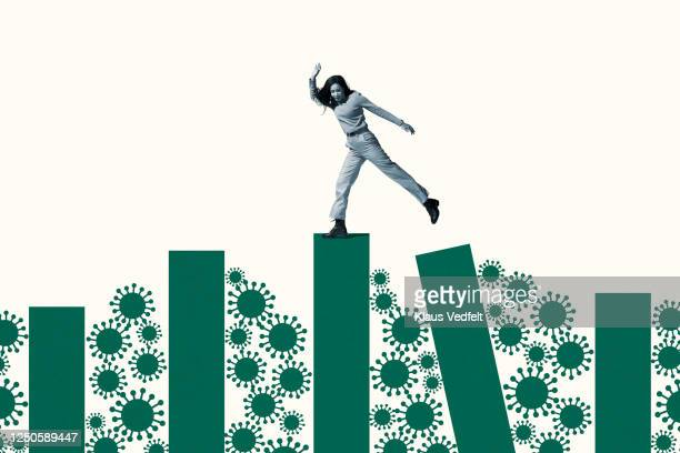 woman balancing on columns amidst coronavirus - individuality stock pictures, royalty-free photos & images