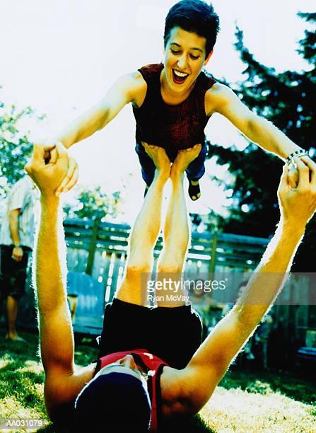 Woman Balancing on Man at Party