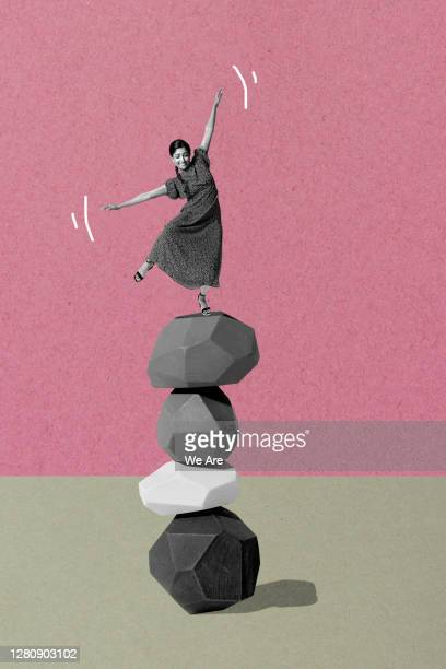 woman balancing on pile of stones - asymmetric dress stock pictures, royalty-free photos & images