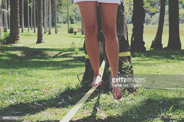 Woman Balancing On Slackline