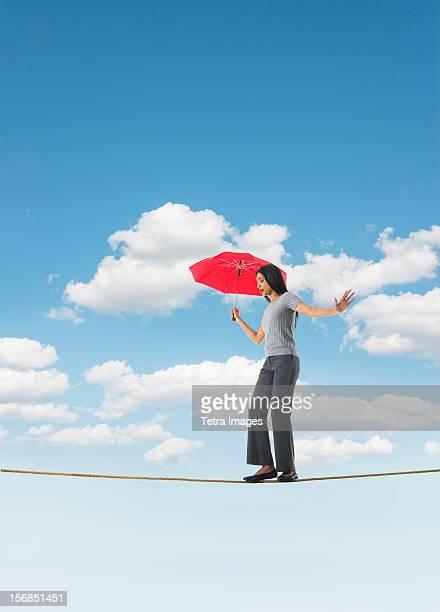 Woman balancing on tightrope