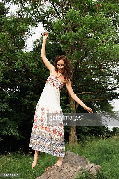 Woman balancing on trunk