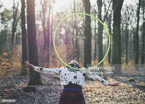 Woman Balancing Plastic Hoop On Her Chest