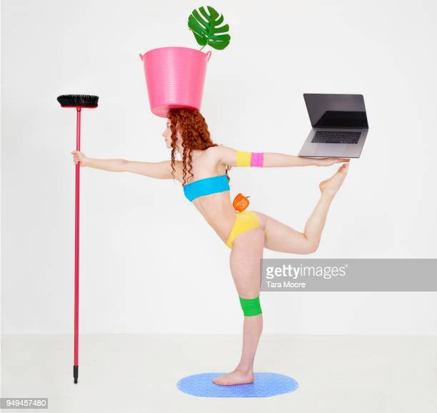 woman balancing several objects on body - broom stock pictures, royalty-free photos & images