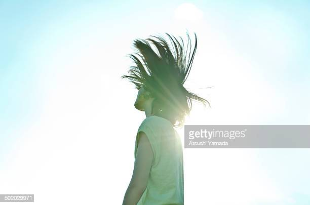 Woman banging head with sky background