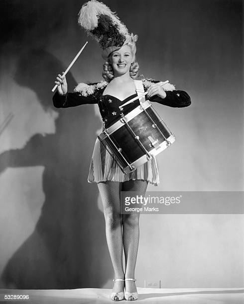 woman banging on drum - drum majorette stock pictures, royalty-free photos & images