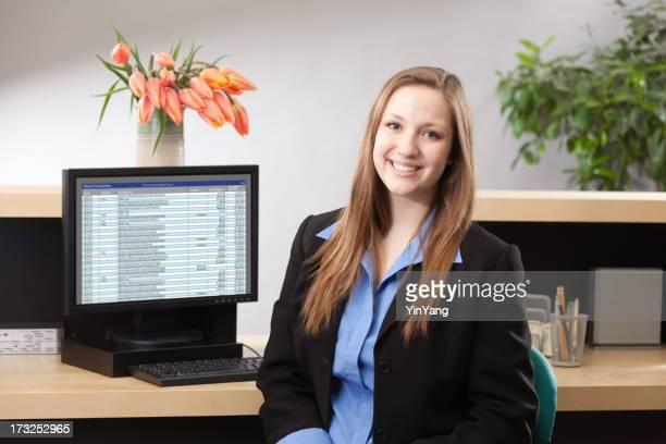 Woman Bank Teller at Retail Banking Counter Providing Financial Service