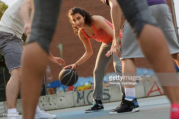 Woman Basketball Player Dribbling Ball