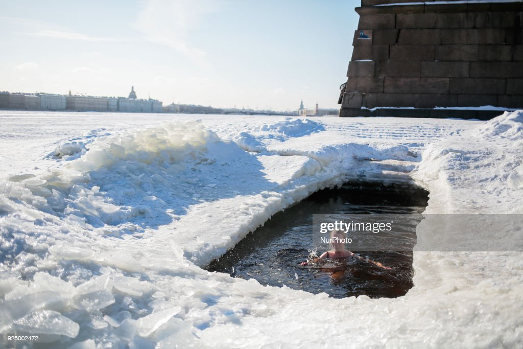 Heavy frozen in russia photos and images getty images a woman bathes in the river neva during the severe frost in st petersburg publicscrutiny Gallery