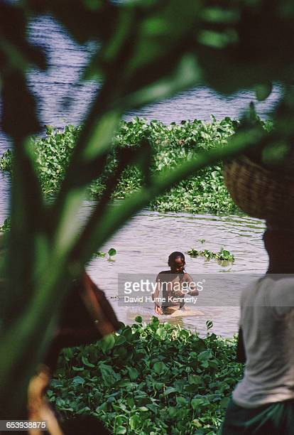 Woman bathing at a refugee camp filled with East Pakistani refugees 1971 on the outskirts of Calcutta the capital of West Bengal and India's largest...