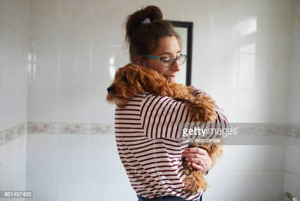 woman bathing her puppy - good condition stock pictures, royalty-free photos & images
