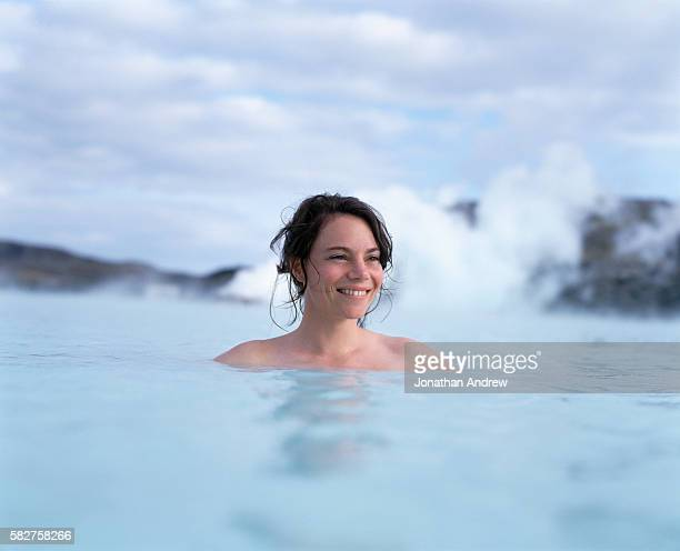 woman bathing in blue lagoon in iceland - blue lagoon iceland stock pictures, royalty-free photos & images