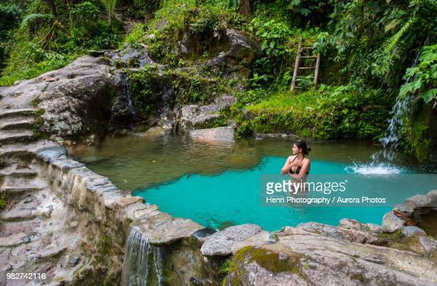 woman bathing in spring in jungle of mindo, pichincha province, ecuador - ecuador fotografías e imágenes de stock