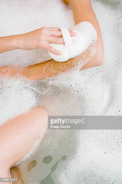 woman bathing - human arm stock pictures, royalty-free photos & images