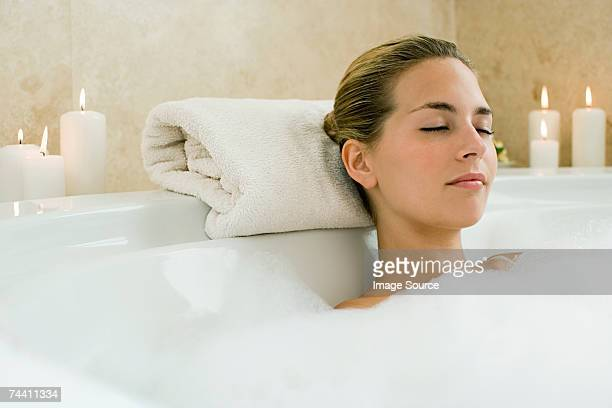 woman bathing - taking a bath stock pictures, royalty-free photos & images