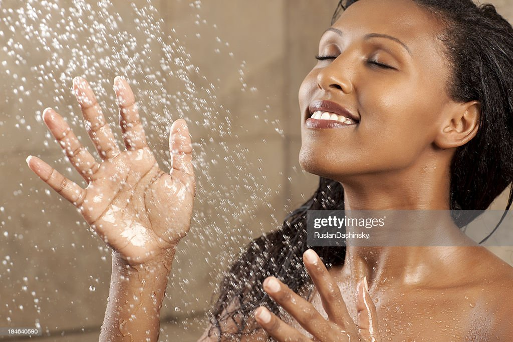 Woman Bathing Under The Shower Stock Photo | Getty Images