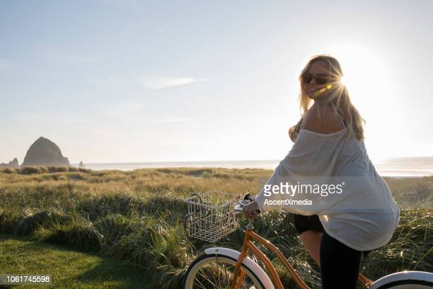 woman  beach - pedal pushers stock pictures, royalty-free photos & images