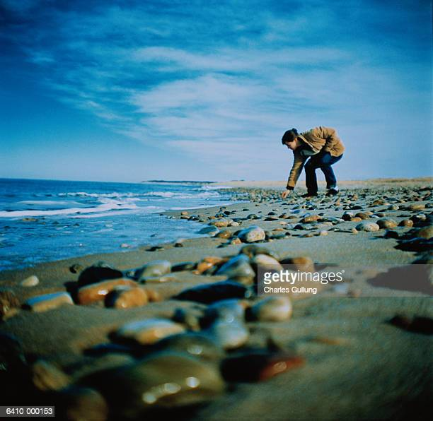 woman beachcombing - bend over woman stock pictures, royalty-free photos & images