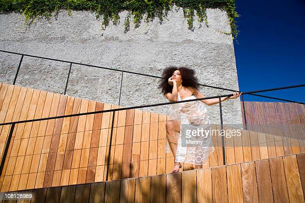 woman beauty,fashion and modern architecture - women in see through dresses stock photos and pictures