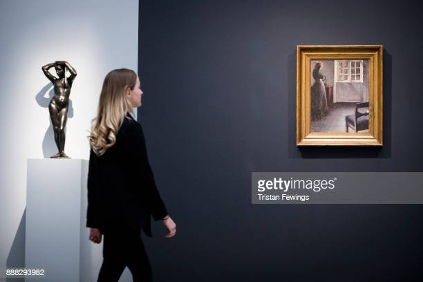 Woman Before a Mirror by Danish artist Vilhelm Hammershoi goes on view as part of the19th Century European Paintings sale at Sotheby's on December 8...