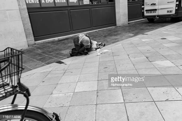 woman begging on a bordeaux street - humane society stock pictures, royalty-free photos & images